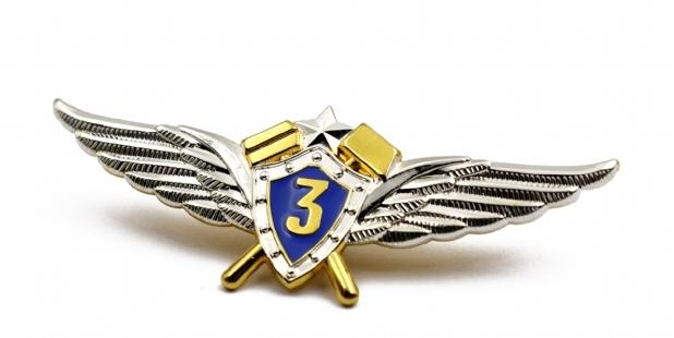 llaveros, pins y medallas